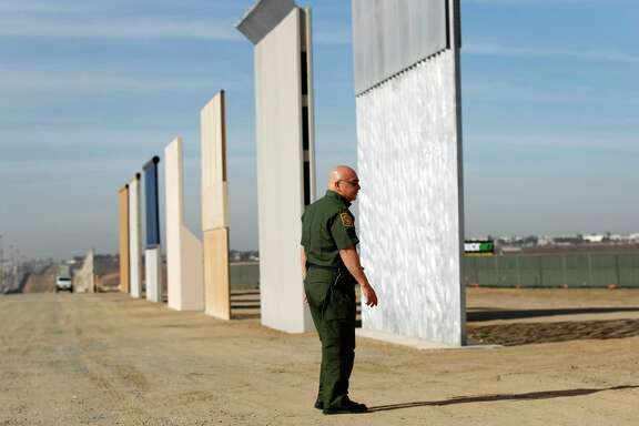 Border wall prototypes stand near San Ysidro, Calif., on the border with Mexico. The Trump administration has softened its stance on having a physical wall along the entire border.