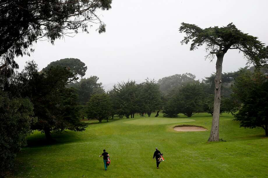 Daniel Hunter (left) and Daniel Rotstein walk to the 3rd hole at the Golden Gate Park Golf Course, one of three that will receive recycled water for irrigation when the new treatment plant is completed in 2021. Photo: Santiago Mejia, The Chronicle