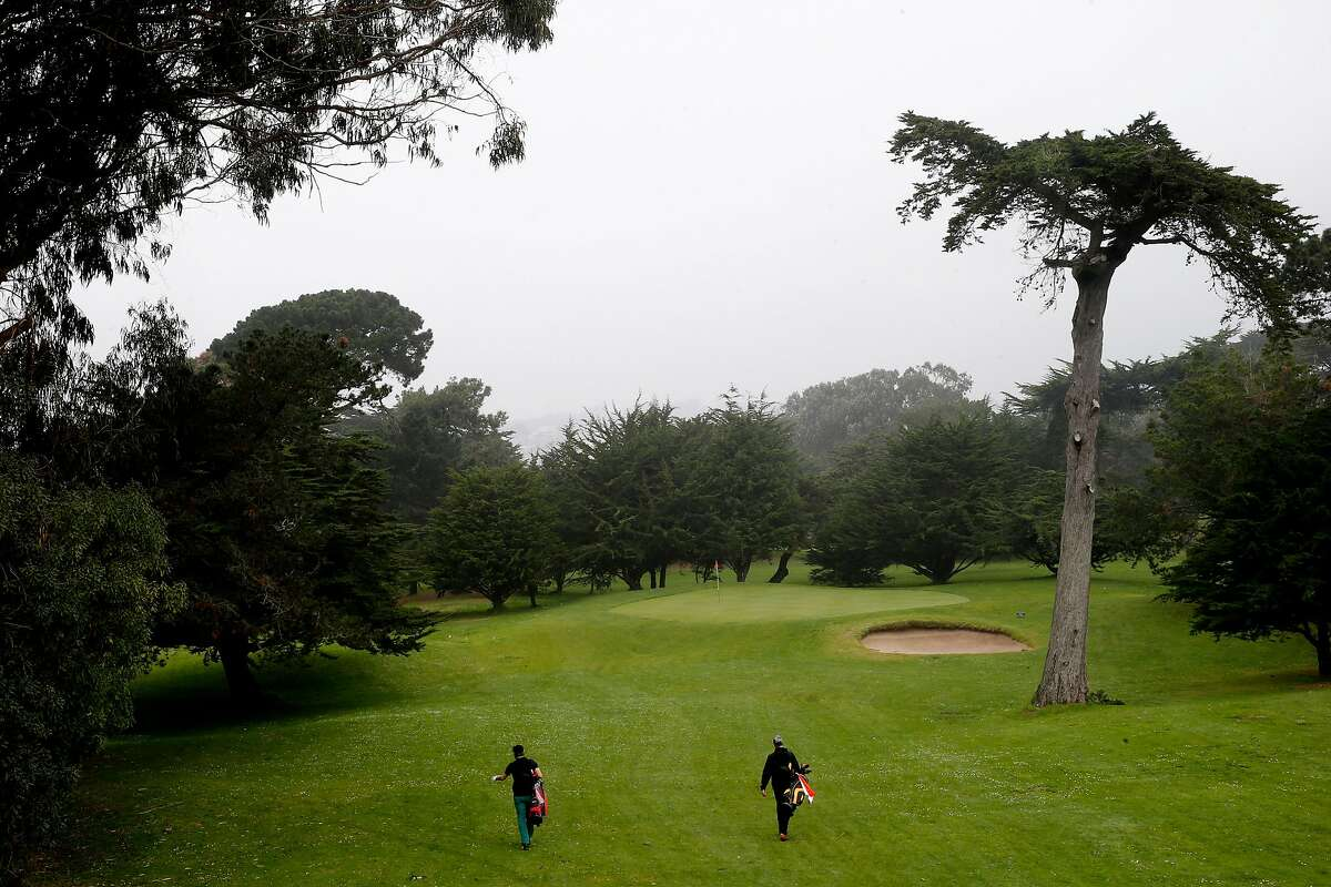From left: Daniel Hunter and Daniel Rotstein walk to Hole 3 at the Golden Gate Park Golf Course, Tuesday, Jan. 16, 2018, in San Francisco, Calif.