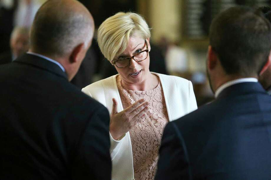 Rep. Sarah Davis, R-Houston, debates at the Capitol during the special session in August. She says her district includes Republicans concerned mostly with business issues, not social issues. Davis fears that narrowing the definition of what it means to be a Republican could alienate people. Photo: Tom Reel, Staff / 2017 SAN ANTONIO EXPRESS-NEWS