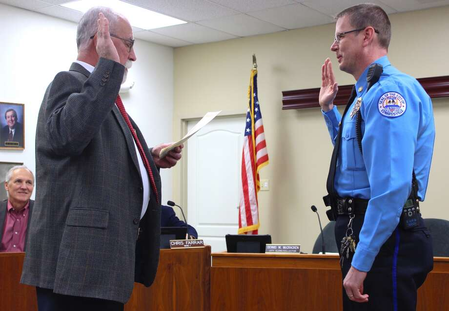 Pictured is Lt. Mike Fillback, of the EPD, swearing in as Major/Deputy Chief at Tuesday's City Council meeting. Photo: Cody King • Cking@edwpub.net