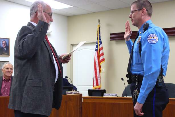 Pictured is Lt. Mike Fillback, of the EPD, swearing in as Major/Deputy Chief at Tuesday's City Council meeting.