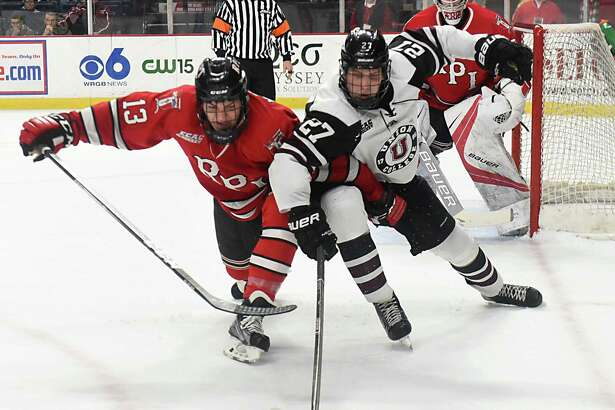 RPI's Jared Wilson battles with Union's Sebastian Vidmar during the Mayor's cup hockey game at the Times Union Center on Thursday, Jan. 19, 2017 in Albany, N.Y. (Lori Van Buren / Times Union)