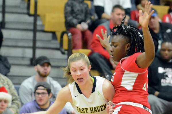 East Haven's Kylie Schlottman tries to get around Wilbur Cross' Tyannah Tucker on Tuesday, Jan. 16, 2018. Scholttman became school's all-time leading scoring with 1,432 points. East Haven won 59-43.