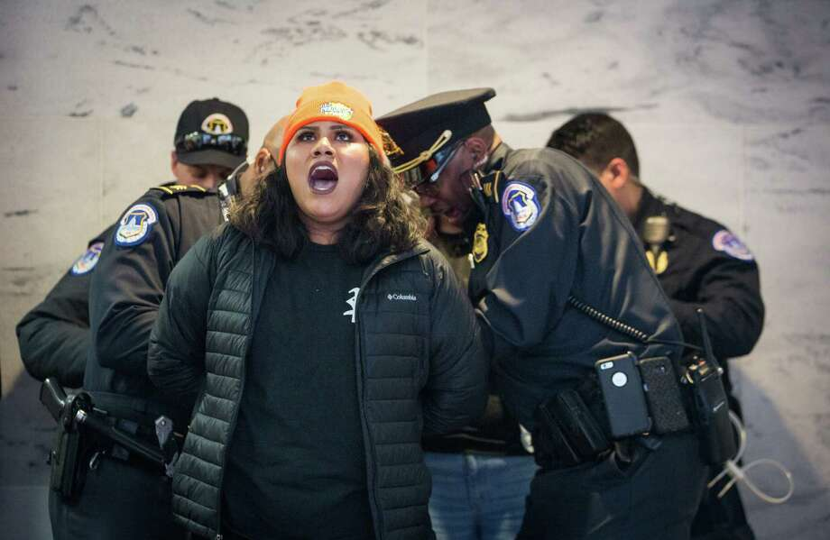 A protester is arrested during a demonstration over the fate of the Deferred Action for Childhood Arrivals program outside the office of Sen. Chuck Grassley (R-Iowa) on Capitol Hill, Jan. 16, 2018. Photo: ERIN SCHAFF / NYTNS