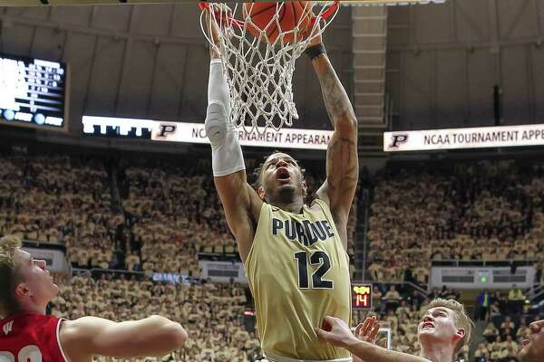 WEST LAFAYETTE, IN - JANUARY 16: Vincent Edwards #12 of the Purdue Boilermakers dunks the ball against the Wisconsin Badgers at Mackey Arena on January 16, 2018 in West Lafayette, Indiana. (Photo by Michael Hickey/Getty Images)