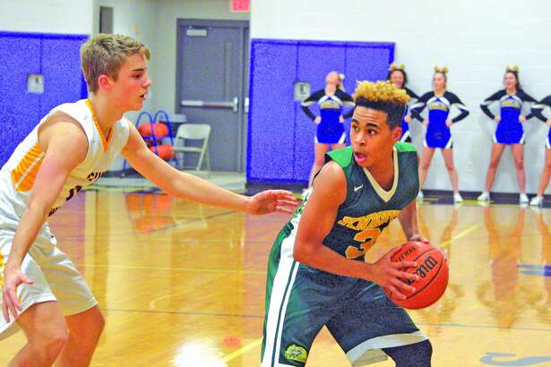 Metro-East Lutheran junior Jason Williams, right, is guarded by a Bethalto Civic Memorial defender during the fourth quarter of Tuesday's game at the Litchfield Invitational.