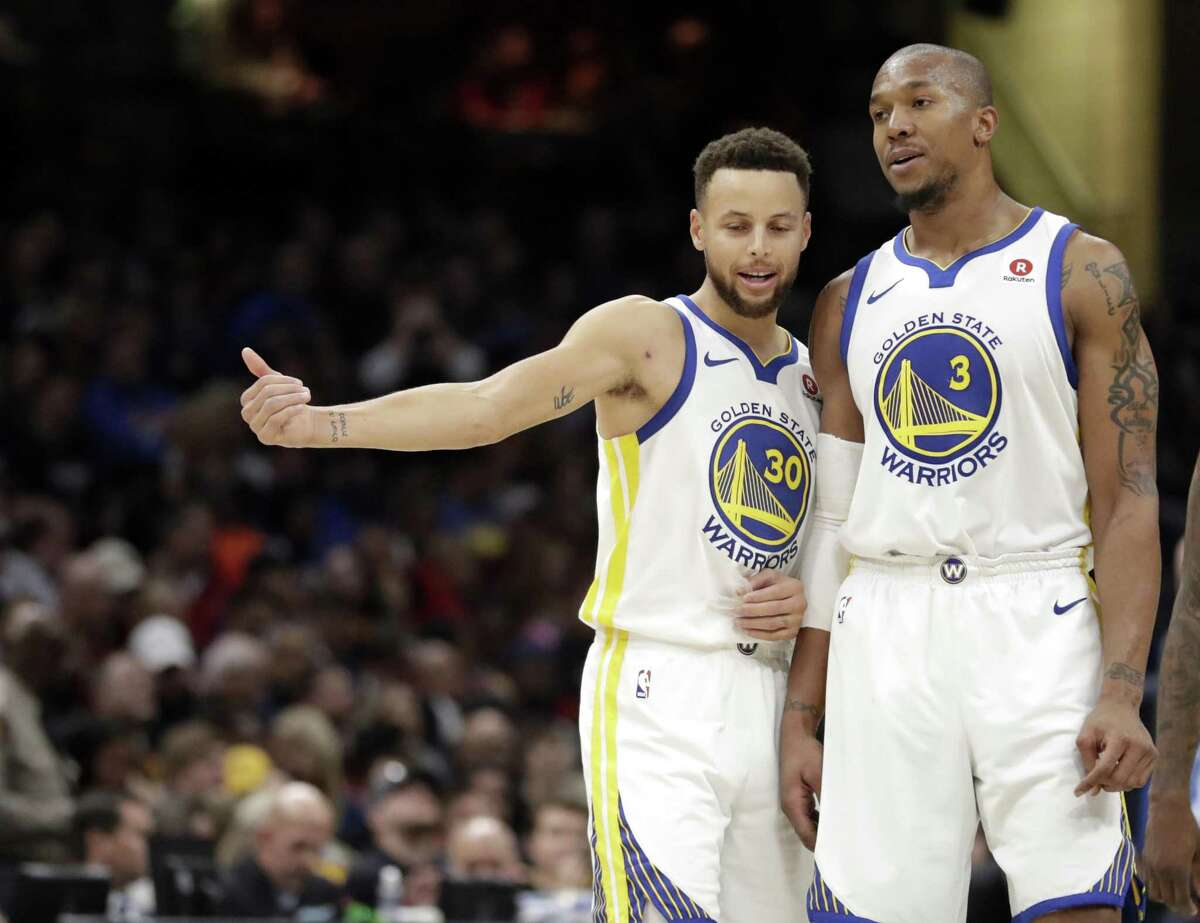 Golden State Warriors' Stephen Curry (30) talks with David West (3) in the second half of an NBA basketball game against the Cleveland Cavaliers, Monday, Jan. 15, 2018, in Cleveland.