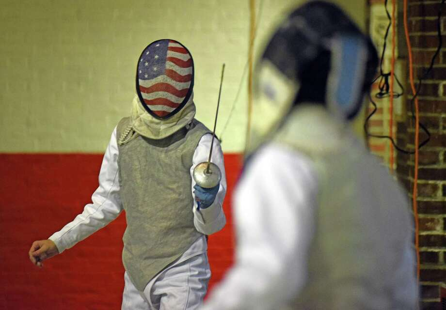 Greens Farms Academy fencer Teddy Gartland, left, a resident of Darien, warms up for a match against Fairfield Prep last week in Fairfield. Photo: Contributed Photo