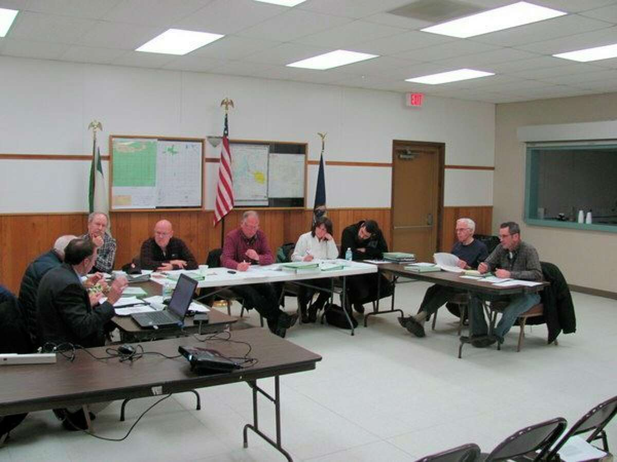 The Ingersoll Township board discussesthe township wind ordinance. From left facing the camera: Rick Surma, Dave Kinne, Chairman Ron Garrett, Kris Kipfmiller, Jacob Terwillegar, George Schaller and Andy Shaffner.