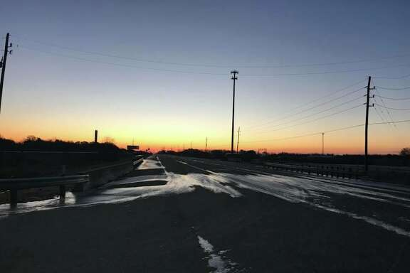 Ice on the road at Highway 36 and FM 1489 on Wednesday morning, posted by the Fort Bend County Sheriff's Office.