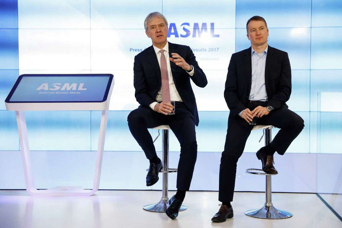 ASML CEO Peter Wennink (left and Wolfgang Nickl, chief financial officer, on Jan. 18, 2018, during a presentation in The Netherlands of the company's year-end results.