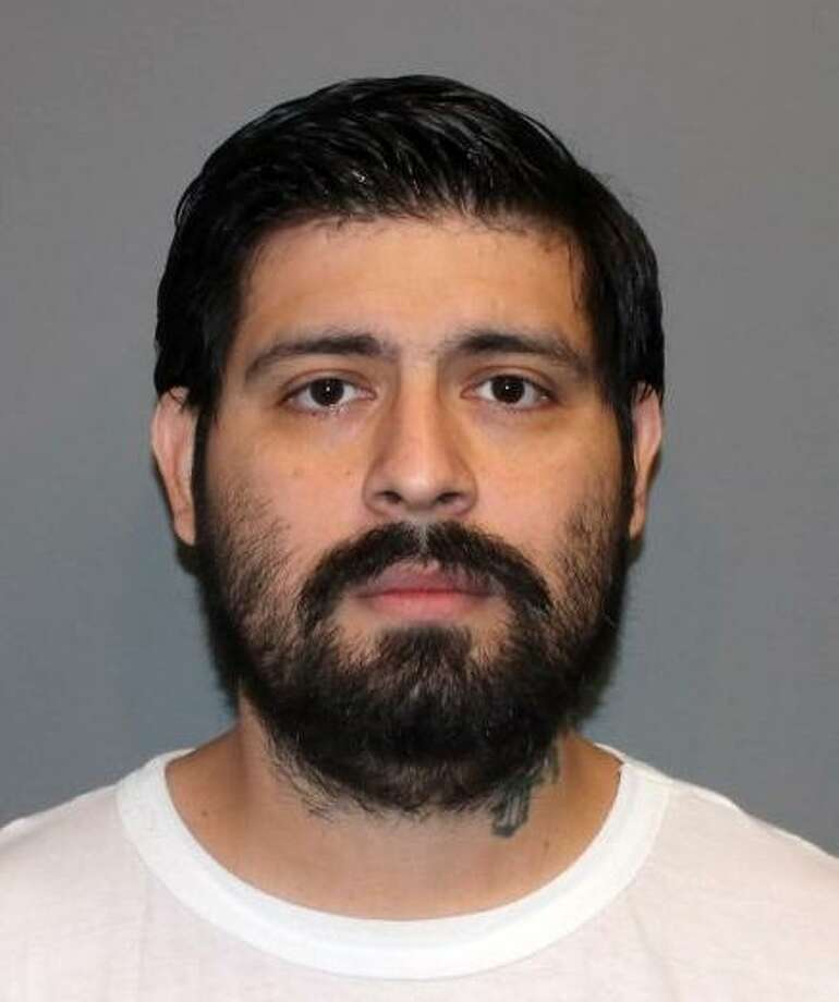 Pedro Salinas, 31, of Norwalk, Conn. was taken into police custody Thursday, July 21, 2016. Salinas was was charged with first-degree assault, and two counts each of cruelty to persons and risk of injury to minors. Photo: Norwalk Police Dept. / Contributed Photo / Norwalk Hour contributed