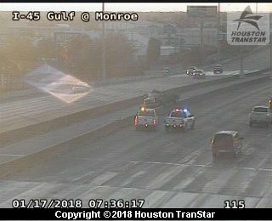 Crews respond to a pickup truck that appears to have crashed and gone over the HOV median on the Gulf Freeway at Monroe on Wednesday, Jan. 17, 2017. Photo: Houston TranStar