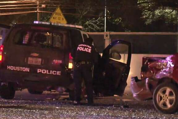 A suspected drunk driver crashed into Houston police SUVs that were parked on the North Loop early Wednesday directing traffic off the highway onto the service road.