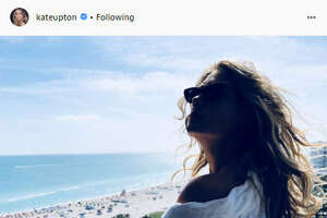 While Houston was experiencing wintry weather causing roads to ice over and freezing temperatures, Kate Upton shared photos of her time in  Miami Beach on Instagram .