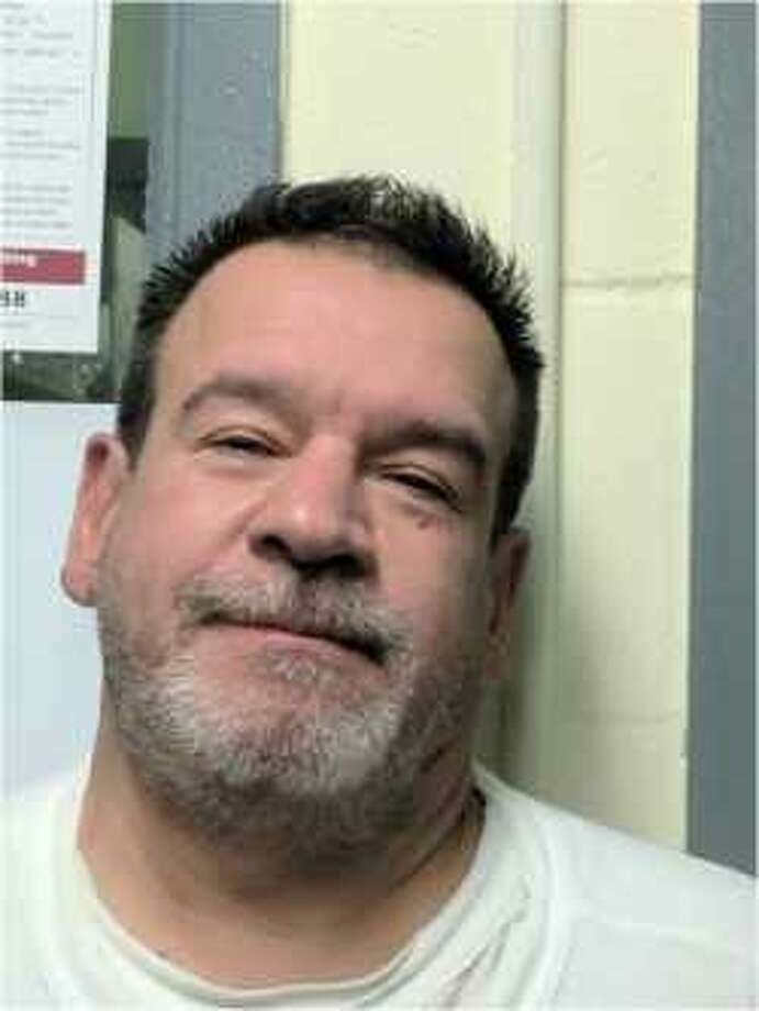 John Mech, 56, of Seaside, Oregon, was charged with stealing $7,500 from a Stamford homeowner for installing a generator in February 2013. Photo: Westport Police Department /