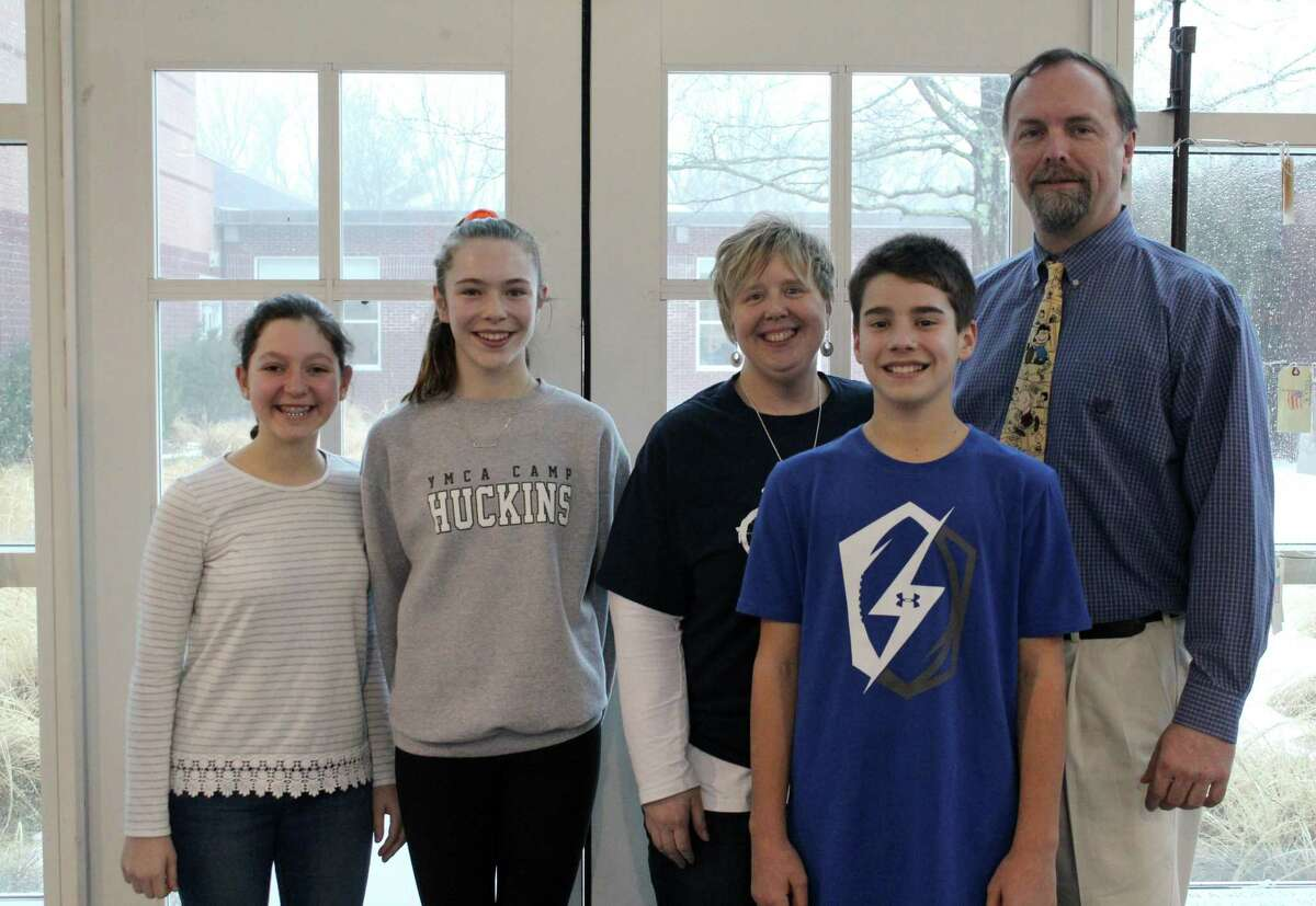 Some of the Middlebrook students and staff, including seventh-grade world geography teacher Cindy Beckmoore (middle), who are a part of the new schoolwide Upstander Empowerment Club.