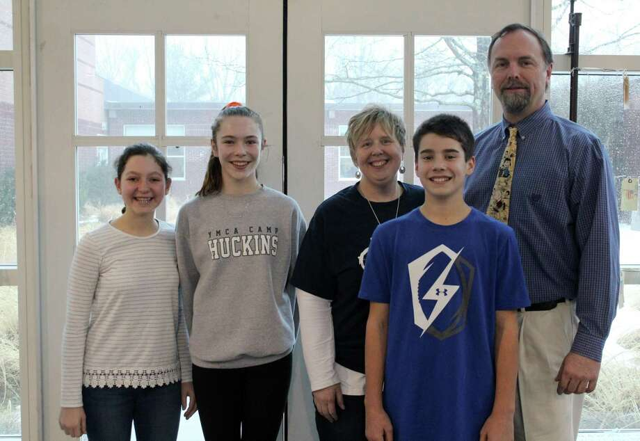 Some of the Middlebrook students and staff, including seventh-grade world geography teacher Cindy Beckmoore (middle), who are a part of the new schoolwide Upstander Empowerment Club. Photo: Stephanie Kim / Hearst Connecticut Media