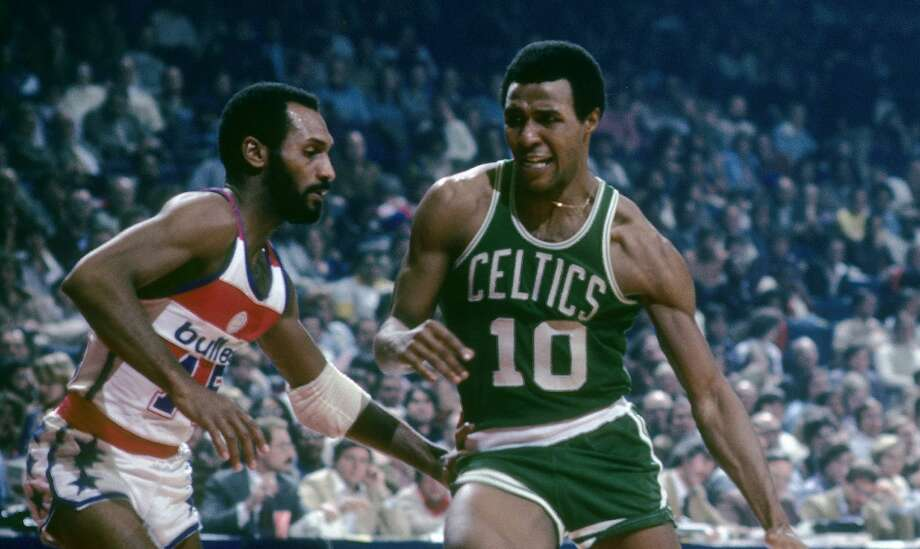 BALTIMORE, MD - CIRCA 1970's: Jo Jo White #10 of the Boston Celtics in action drives on Charles Johnson #15 of the Washington Bullets during a late circa 1970's NBA basketball game at the Baltimore Arena in Baltimore, Maryland. White played for the Celtics from 1969 - 78. (Photo by Focus on Sport/Getty Images) Photo: Focus On Sport/Getty Images