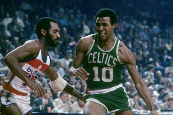 BALTIMORE, MD - CIRCA 1970's: Jo Jo White #10 of the Boston Celtics in action drives on Charles Johnson #15 of the Washington Bullets during a late circa 1970's NBA basketball game at the Baltimore Arena in Baltimore, Maryland. White played for the Celtics from 1969 - 78. (Photo by Focus on Sport/Getty Images)