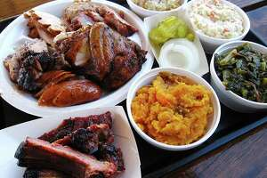 A Family Pack sampler includes all the meats and two sides, shown here with two extra sides and a half-pound of babyback ribs from Big Bib BBQ.