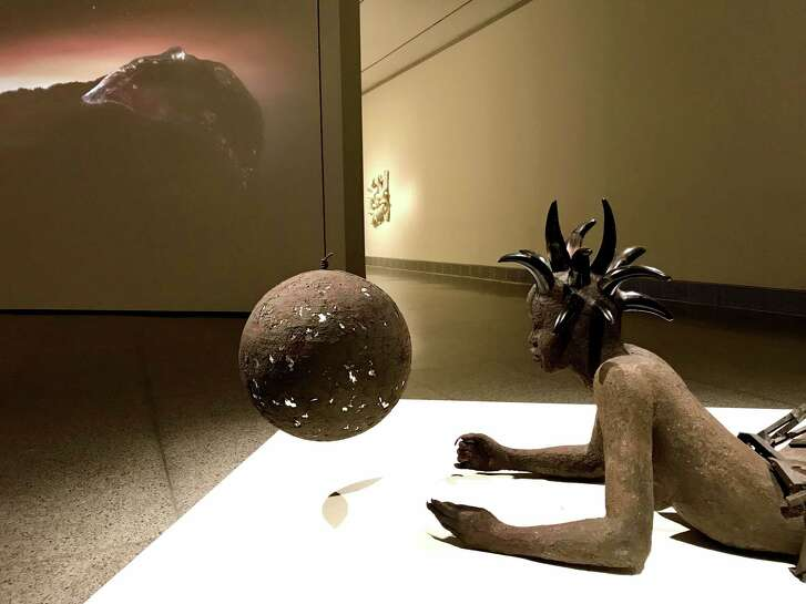 "A view of Wangechi Mutu's sculpture ""She's got the whole world in her,"" one of the three pieces of her installation ""A Trinity,"" on view through Feb. 4 at the Museum of Fine Arts, Houston in the show ""On Common Ground: Recent Acquisitions in Contemporary Art."""