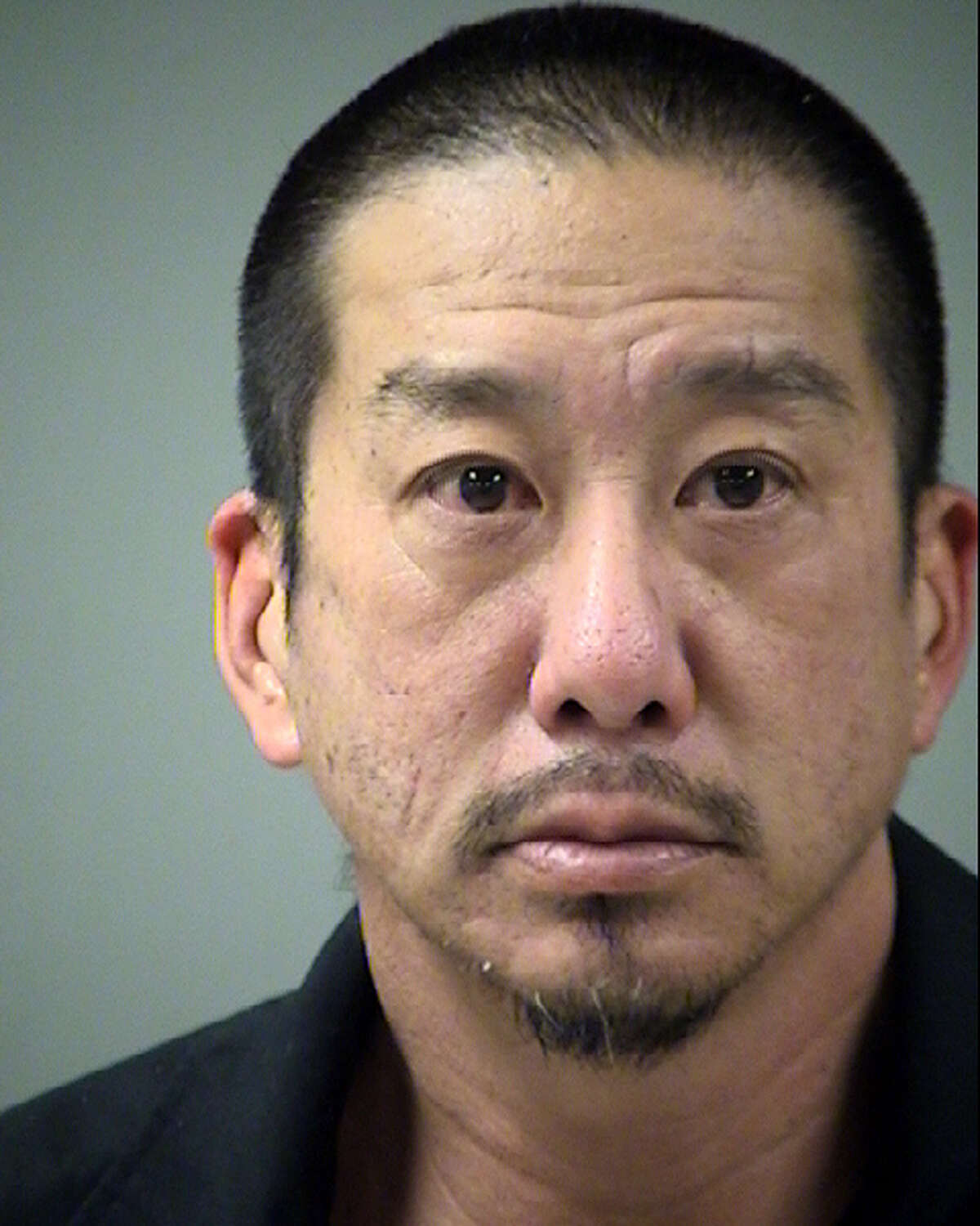 Reid Shizuo Kamitono, 47, is accused of tampering with evidence by trying to conceal a corpse.