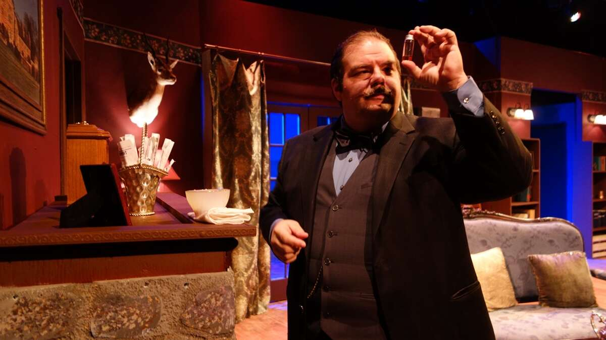 Detective Hercule Poirot (Sean DeFlora) collects evidence in Clear Creek Community Theatre's production of Agatha Christie's