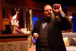 """Detective Hercule Poirot (Sean DeFlora) collects evidence in Clear Creek Community Theatre's production of Agatha Christie's """"Black Coffee,"""" which is onstage through Jan. 29."""
