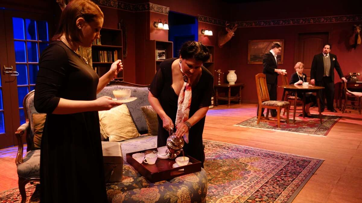 Barbara Amory (Chelse Tillman) waits as Lucia Amory (C.Alane Johnson) pours coffee after dinner. Actors Bob Townsend, Julia Jay and Jeff Coletta are at the table.