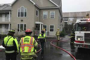 Firefighters respond to an apartment fire Wednesday morning on Strawberry Hill Avenue.