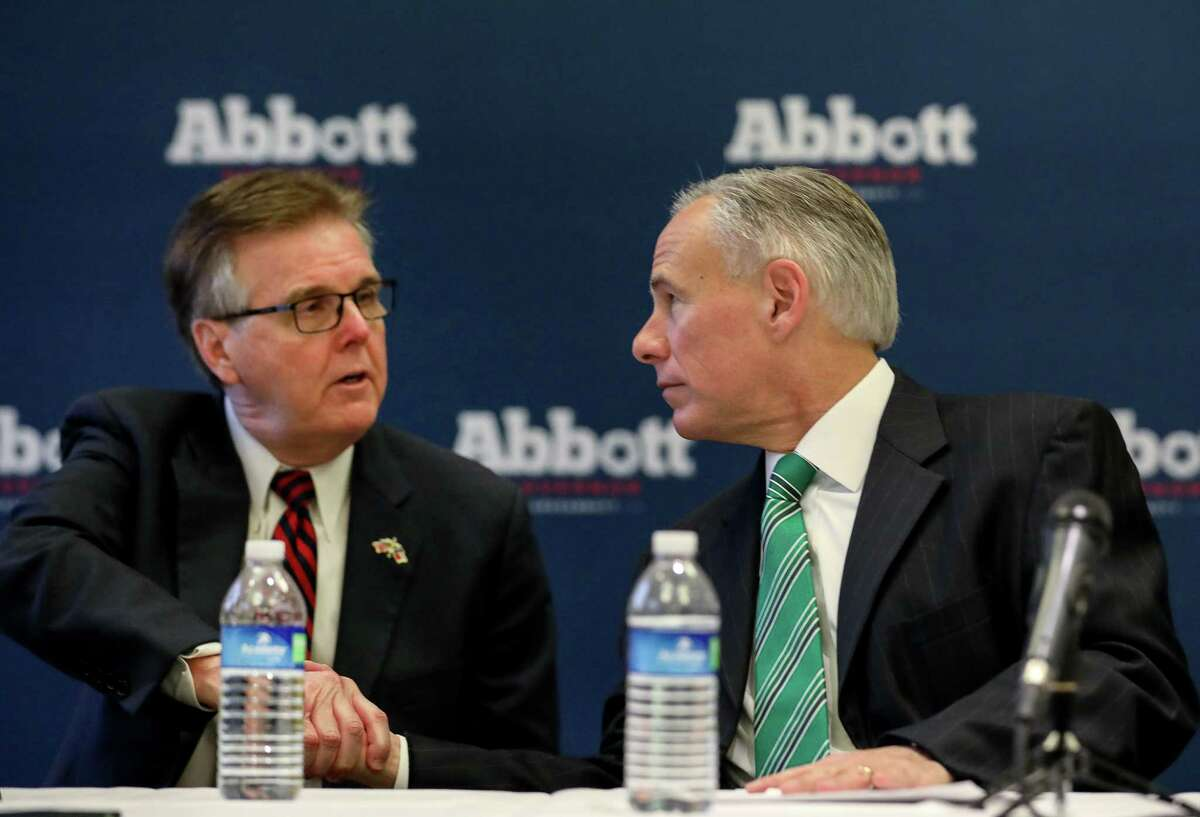 Governor Greg Abbott, right, shakes hands with Lt. Gov. Dan Patrick after a press conference about a new property tax proposal, at the Westin Galleria hotel, Tuesday, Jan. 16, 2018, in Houston. ( Jon Shapley / Houston Chronicle )