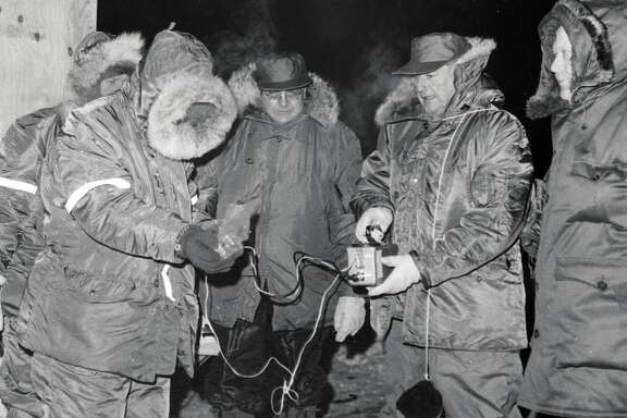 Radiation specialist Lt. D. J. Dahlen (L) and Major Gen. Richard O. Hunziker ready Geiger counter for inspection of the B-52 crash area in Greenalnd in 1968. At right is Dr. J. Kock of Danish atomic research station. In the center is an unidentified Danish scientist.