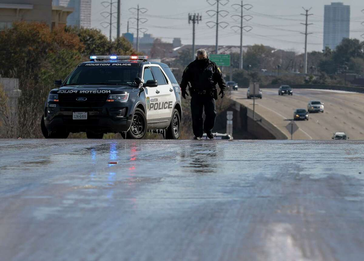 Houston Police divert traffic off of IH-69 near the Weslayan Street and Newcastle Drive exits because of ice on the roadway, Wednesday, Jan. 17, 2018, in Houston.