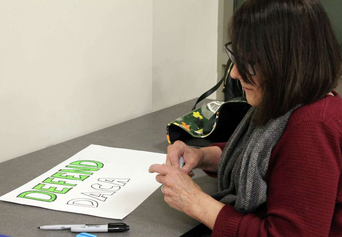 Wilton Democrats made signs for the Women's March in New York City on Jan. 20, after the Wilton Town Democratic Committee biennial Caucus on Tuesday.