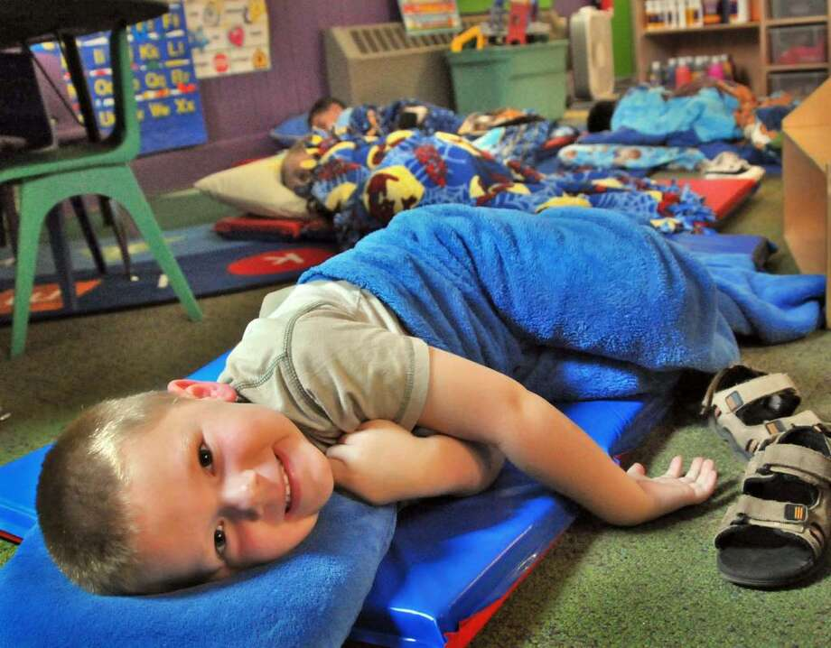 5-year-old Ethan Mattison isn't quite asleep during rest time at Whistle Stop Learning Center, a new Mechanicville Community Center pre-school and day care Thursday. The center experienced difficutlies when a member item was slow to arrive.  (John Carl D'Annibale / Times Union) Photo: John Carl D'Annibale / 00004748A