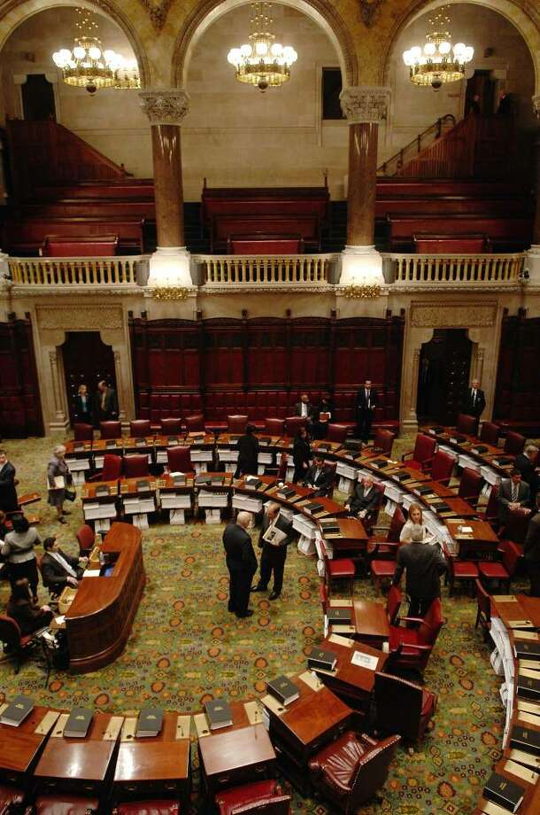 Senators and staff work on the floor of the Senate Chambers  during the special session at the Capitol in Albany on Monday.   (Paul Buckowski / Times Union) Photo: PAUL BUCKOWSKI / 00006611A