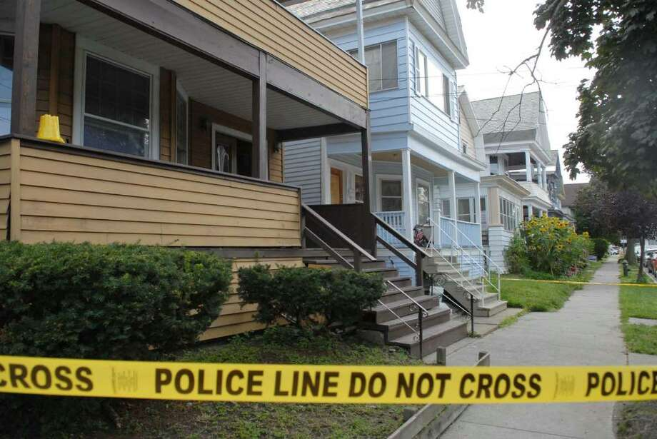 Police tape marks the area at the scene on Magnolia Terrace in Albany, NY, where a body of a teenager was found Wednesday evening.    (Paul Buckowski / Times Union) Photo: PAUL BUCKOWSKI / 00005365A