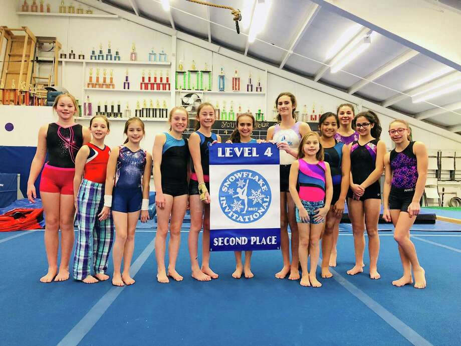 The Wilton Y gymnastics team Level 4 squad took second place at the Snowflake Invitational last month. Team members include, from left to right, Lauren Condon, Cailyn Cruickshank, Kaelyn Talisse, Ella Mancuso, Ella Arghirescu, Emma Incao, Simona Gheorghe, Taylor Archambeau, Madeline Mosquera, Nina Ferrucci, Sofia Vitti, and Jeni Von Bartheld. Photo: Contributed Photo/Hearst Media Connecticut