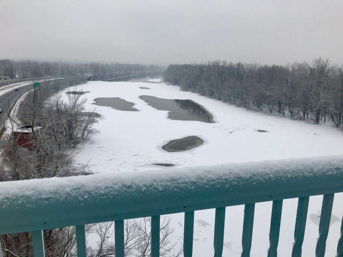 The flooded and, in parts, ice-jammed Connecticut River in upper Middlesex County Wednesday is shown from multiple vantage points, including the Arrigoni Bridge in Portland, Haddam Meadows, Eagle Landing State Park, River Road and Harbor Park in Middletown.