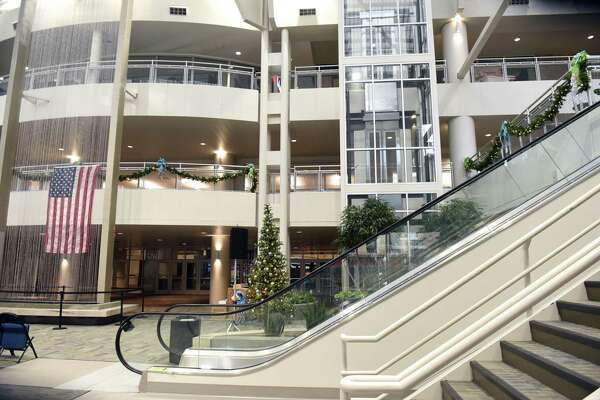 The new enclosed atrium with a glass elevator, new escalators and three-story waterfall is seen during a preview tour of the new renovations at the Times Union Center on Thursday, Jan. 11, 2018 in Albany, N.Y. This space used to be open to the outside. (Lori Van Buren/Times Union)
