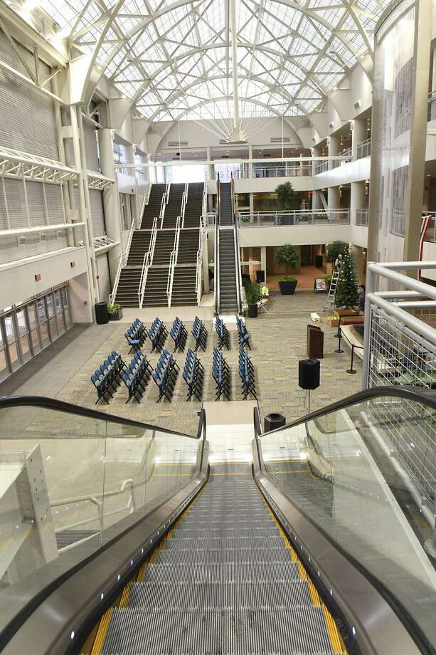 The new enclosed atrium with a glass elevator, new escalators and three-story waterfall is seen during a preview tour of the new renovations at the Times Union Center on Thursday, Jan. 11, 2018 in Albany, N.Y. This space used to be open to the outside. (Lori Van Buren/Times Union) Photo: Lori Van Buren / 20042641A