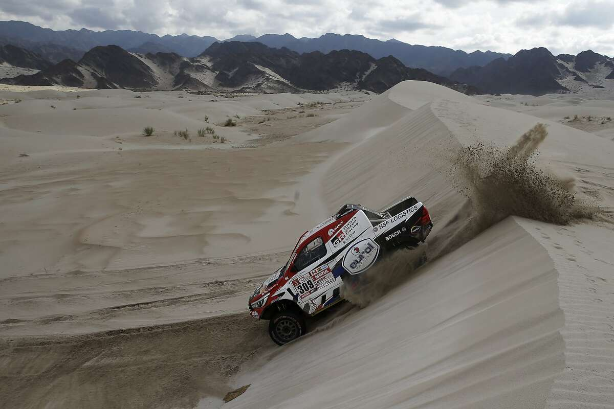 Driver Bernhard Ten Brinke, of Netherlands, and co-driver Michel Perin, of France, race their Toyota during stage 11 of the 2018 Dakar Rally between Belen and Chilecito/Fiambala, Argentina, Wednesday, Jan. 17, 2018. (AP Photo/Ricardo Mazalan)