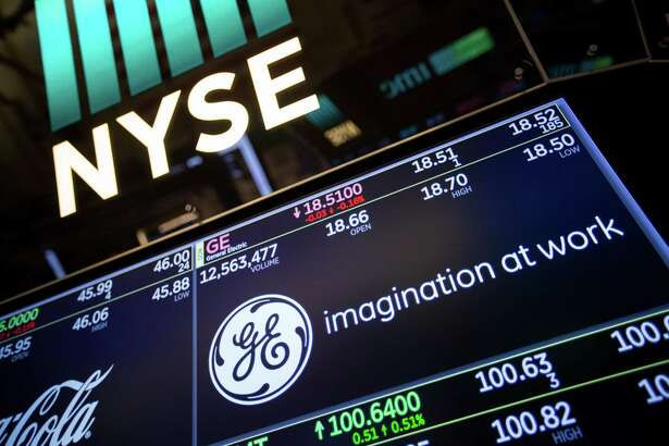 A monitor displays the GE logo on the floor of the New York Stock Exchange in New York on Jan. 8, 2018.