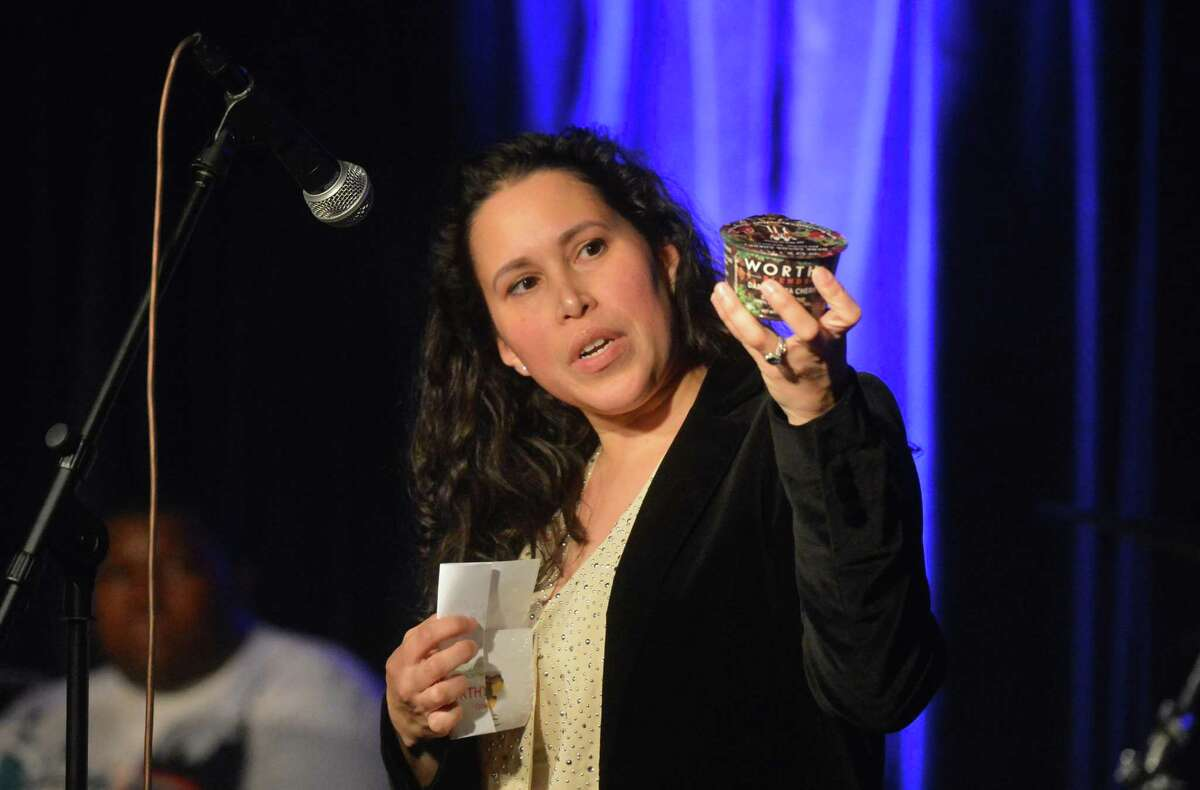 Nydia Shipman shows her nutritional product and talks about her start-up Worthy during the Northeast Community Innovation Corp. Holiday Pitch Night at The Factory Underground on Wednesday December 6, 2017 in Norwalk Conn. Local Entrepreneurs are judged on their product and compete for a cash prize by pitching their best ideas for new businesses.