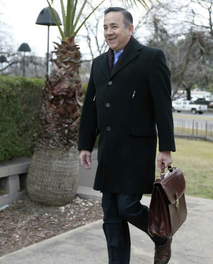 State Sen. Carlos Uresti on Wednesday arrives at the John H. Wood Jr. Federal Courthouse for a pretrial conference. Jury selection in Uresti's criminal fraud trial gets under way Thursday morning. Photo: William Luther /San Antonio Express-News / © 2018 San Antonio Express-News