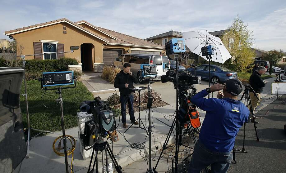 Members of the media work outside a home Tuesday, Jan. 16, 2018, where police arrested a couple on Sunday accused of holding 13 children captive, in Perris, Calif. Authorities said an emaciated teenager led deputies to the California home where her 12 brothers and sisters were locked up in filthy conditions, with some of them malnourished and chained to beds. (AP Photo/Alex Gallardo) Photo: Alex Gallardo, Associated Press