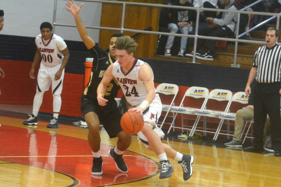 Plainview's Carson Hauk, 24, dribbles past an opponent during a game earlier this season. The senior guard scored 15 points in a loss at Palo Duro Tuesday night. Photo: Skip Leon/Plainview Herald