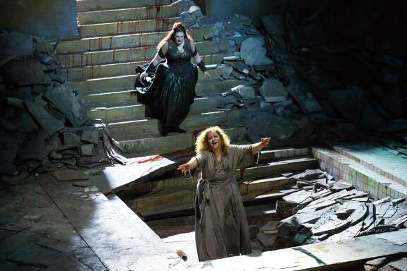 "Christine Goerke stars as Elektra, front, and Tamara Wilson as Chrysothemis in the Houston Grand Opera's production of ""Elektra."""